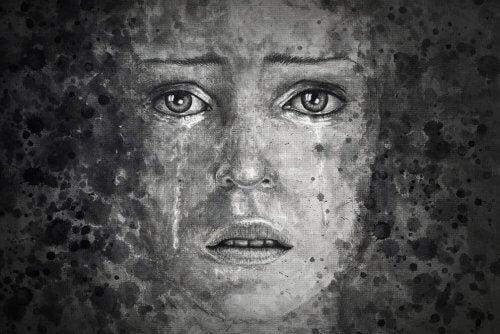 Sort og hvidt portræt af en pige, der græder