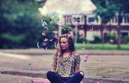Pige under sky, der regner med konfetti, nyder gode livsværdier