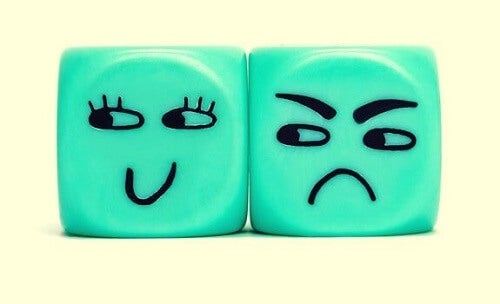 Blå vred terning illustrerer at være misundelig over smilende ternings glæde