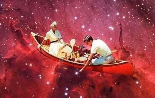 Par i båd flydende på rødt hav