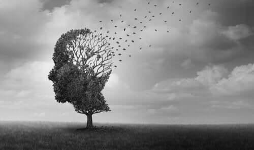 Træ formet som hoved, hvor bladene flyver væk som fugle
