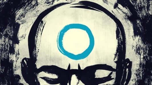 mand med blå cirkel i panden