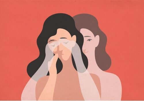 Kvinde tører tårer væk og prøver at slukke sine følelsesmæssige knapper