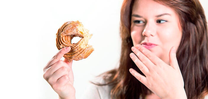 Kvinde med donut mærker forbindelsen mellem overvægt og skyld