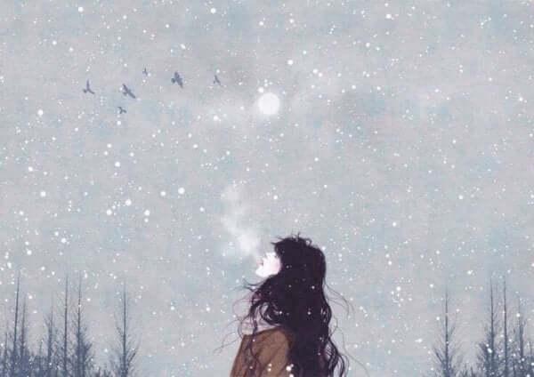 kvinde ånder i vinternat ved at styre sit åndedræt