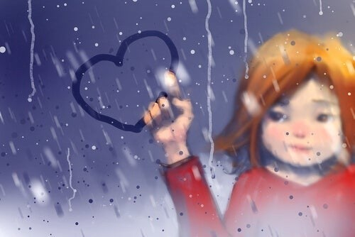 Pige tegner et hjerte på en rude