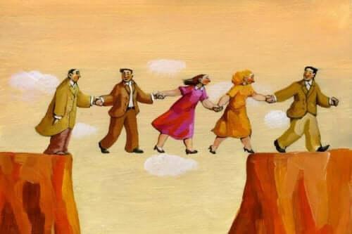 Social neurovidenskab illustreres af personer, der løfter hinanden over kløft