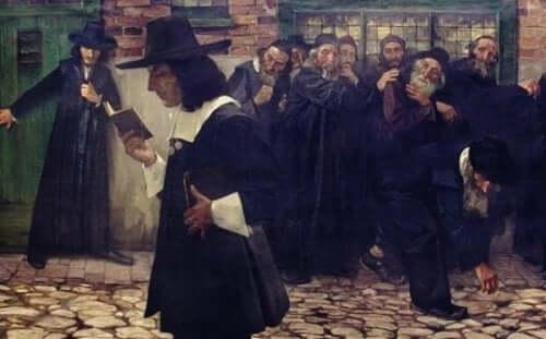 Maleri af Baruch Spinoza, der går og læser på en gade