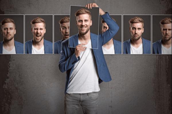 Mand med forskellige ansigtsudtryk illustrerer personlighedspsykologi