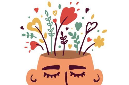 Abstrakt tænkning illustreres af person, hvor blomster vokser ud af hovedet